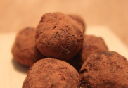 Image of high energy snack containing prunes, dusted with cocoa powder